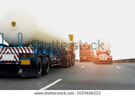 Gas or oil Truck on highway road container, transportation concept.,import,export logistic industrial Transporting Land transport on the asphalt expressway #1033606222