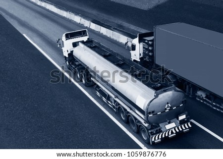 Gas or oil Truck on highway road with container, transportation concept.,import,export logistic industrial Transporting Land transport on the asphalt expressway. #1059876776