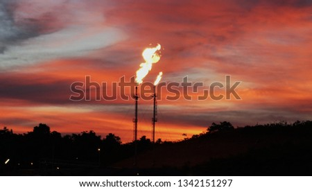 Gas plant flare stack.. Sunset flare stack #1342151297