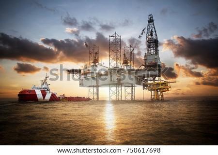 Gas platform or rig platform in sunset or sunrise time. #750617698