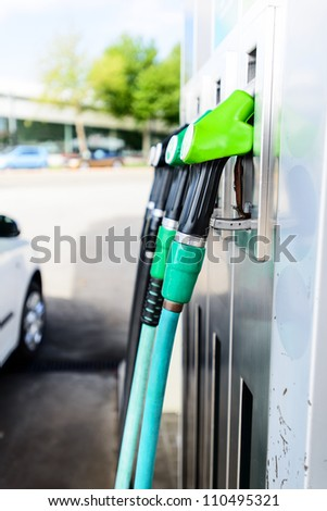 Gas pump nozzles at gas pump