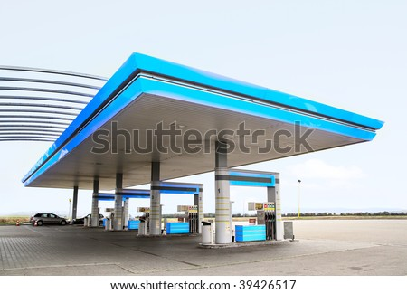 Gas refuel station with blue roof close-up