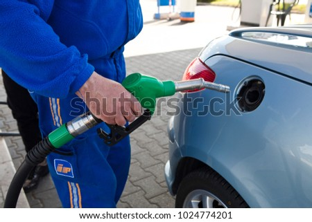 gas station and gasoline in the car