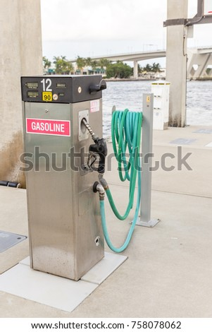 Gas station for ships and boats  in the harbor. diesel dispenser. Energy and power concept. #758078062