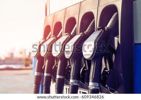 Gas station. Gas station in the mountains. Guns for refueling at a gas station on a sunset day in the summer in the mountains. Car pulls up to refuel. Service                        #609346826