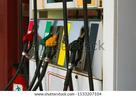 Gas station. Petrol pump in gas station. Filling the column with different fuels at the gas station. #1533207104