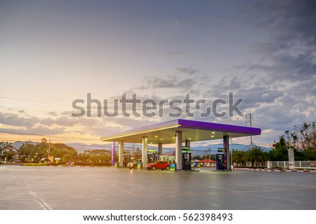 gas station with clouds and sky at sunset #562398493