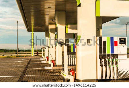 Gas station with columns for fueling various fuel on a background of blue sky #1496114225