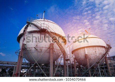 Gas storage sphere tanks in oil and gas refinery industrial plant on blue sky with white cloud background #1034070466