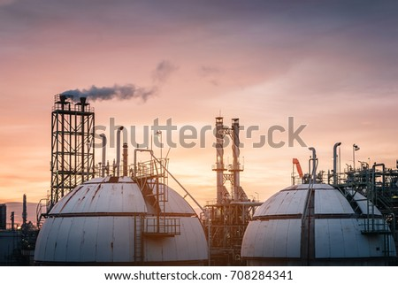Gas storage spheres tank in oil refinery industrial on sky sunset background, Petrochemical plant with evening, Factory at twilight time #708284341