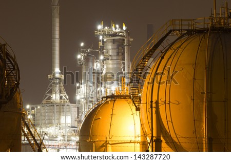 Gas storage tanks and a large oil-refinery plant