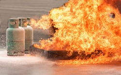 Gas tank under explosion on fire danger accident and risk for people around area.