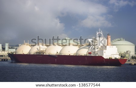 Gas tanker loading in port, Japan