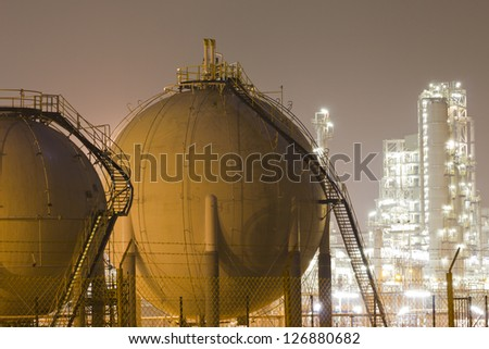 Gas tanks and a large oil-refinery plant
