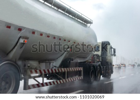 Gas Truck on highway road with tank oil  container, transportation concept.,import,export logistic industrial Transporting Land transport on rain is falling on the asphalt road. #1101020069