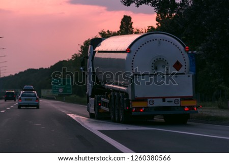 Gas Truck on highway road with tank oil container, transportation concept.,import,export logistic industrial Transporting Land transport on the asphalt expressway with blue sky #1260380566