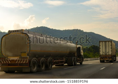 Gas Truck on highway road with tank oil  container, transportation concept.,import,export logistic industrial Transporting Land transport on the asphalt expressway with mountain and sky #1518859196
