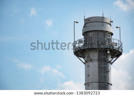 Gas turbine electrical power plant, energy for concept factory, refinery industry, natural gas storage tank at blue sky background #1383092723