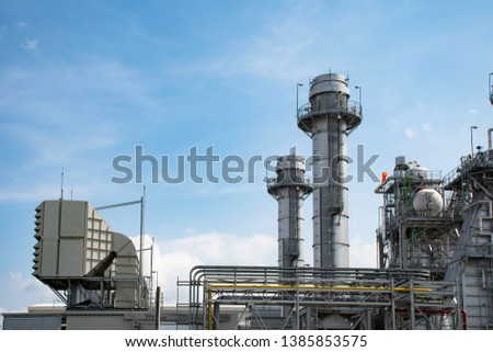 Gas turbine electrical power plant, energy for concept factory, refinery industry at blue sky background #1385853575