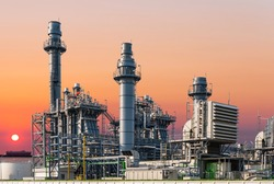 Gas turbine electric power plant industry in asian industrial estate isolated on sky of sunset and cargo ship background. Business gas turbine electricity generator.