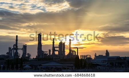 Gas turbine electrical power plant at dusk with orange sky #684868618
