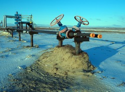 Gas valve, high pressure pipes. Spring arctic tundra. Art noise
