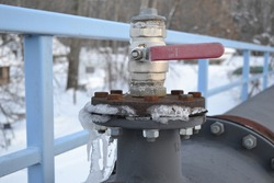 Gas valve with pipes covered with ice