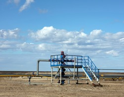 Gas well, high pressure pipes. Spring arctic tundra. Art noise