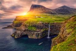 Gasadalur village and Beautiful  waterfall, At Sunset, Vagar, Faroe Islands, Denmark.