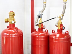 Gaseous fire suppression modules storage containers with shut-off device and valve