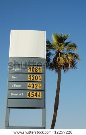 Gasoline prices & palm tree; Baker, California - stock photo