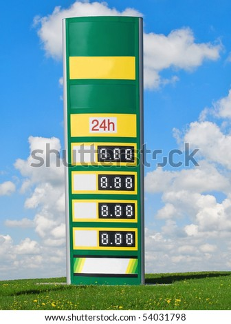 gasoline prices on a sign with sky and clouds in background