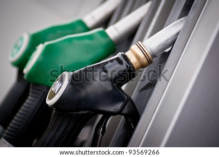 gasoline pump nozzles - stock photo
