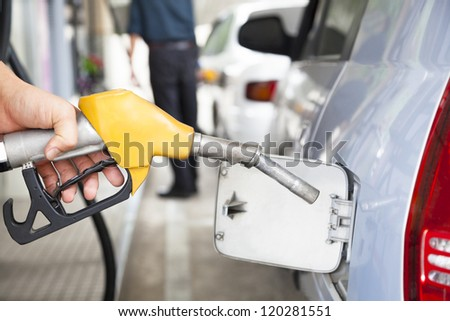 Gasoline pump refilling automobile fuel
