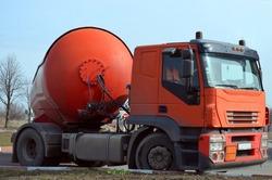 Gasoline tanker red fuel tank. Oil trailer, truck on road. Transportation fuel