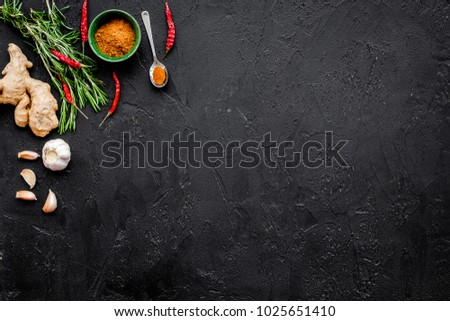 Gastronomy, culinary. Secrets of tasty dishes. Seasoning and spices. Rosemary, ginger, chili pepper on black background top view copy space #1025651410