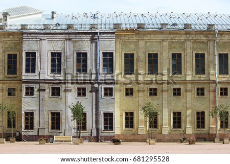 Gatchina Palace in the process of restoration - scaffolding hidden behind the false facade, repeating the decor of the building. #681295528