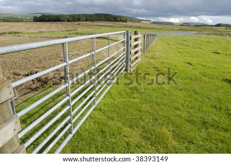 Gate and fence in farm fields in South Scotland