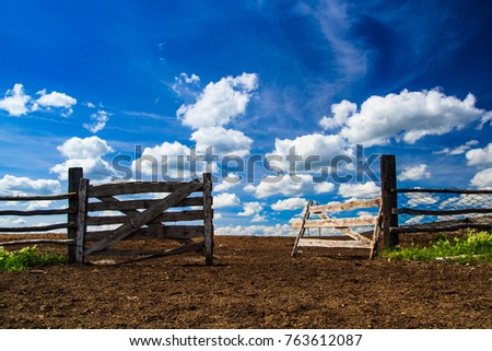 gate from a log on a farm with...