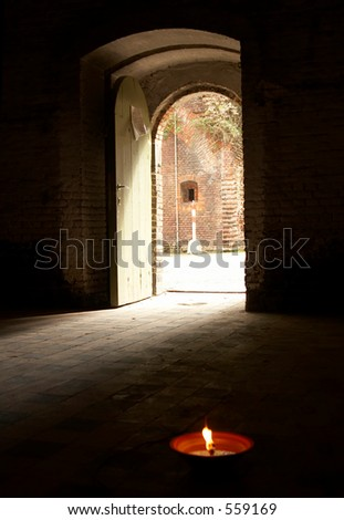 Gate leading to the outside, candle in the front