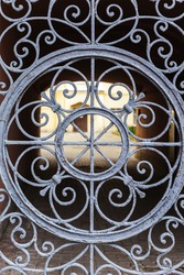 Gate metall decorative grill. Vintage gate forged grill. Old gates decorative elements.