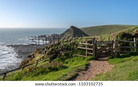 Gate over headlands on south west coastal path near Hartland Quay in North Devon, England