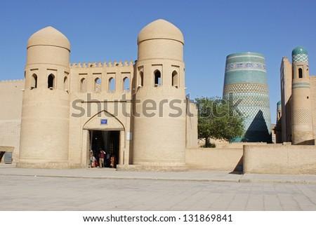 Gate to the ancient city of Khiva with minaret Kalta Minor, silk road, Uzbekistan, Central Asia