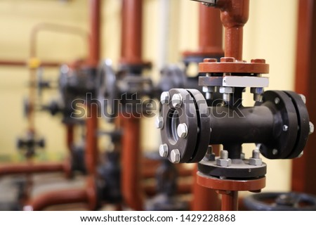 Gate valves and water pipeline on industrial plant. Oil and gas processing plant with pipe line valves #1429228868