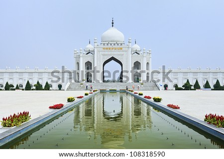 Gate with staircase of a Mosque reflected in a pond at the Hui Cultural Center in Yinchuan, Ningxia Province, China