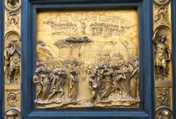 Gates of Paradise with Bible stories on door of Duomo Baptistry in Florence, Italy