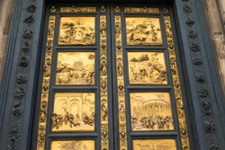 Gates of Paradise with Bible stories on door of Duomo Baptistry in Florence, Italy.  Architecture and landmarks of Florence