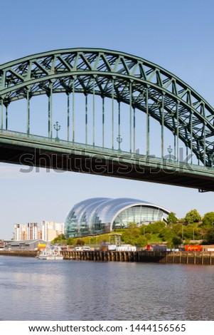 GATESHEAD, ENGLAND - MAY 21, 2018:  The landmark Sage viewed from beneath the Tyne Bridge in Newcastle upon Tyne, England on May 21, 2018.  The Sage is a centre for musical education and performance. #1444156565