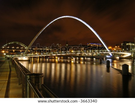 Gateshead Millennium Bridge and Tyne Bridge at sunset