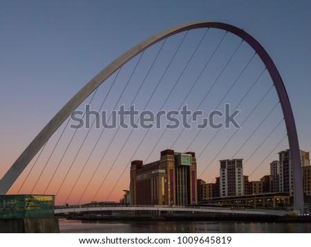 GATESHEAD, TYNE AND WEAR/UK - JANUARY 20 : View of the Millennium Bridge at dusk in Gateshead, Tyne and Wear on January 20, 2018 #1009645819